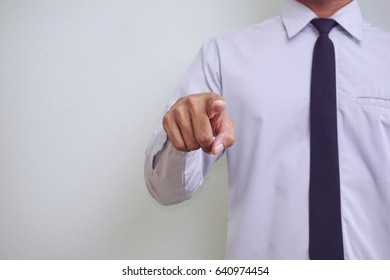 young asian businessman pointing or touching empty virtual screen at front of him.