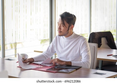 young asian businessman working in startup office, happy work concept