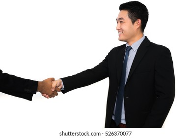 Young Asian businessmen handshake on isolated white backgrounds.