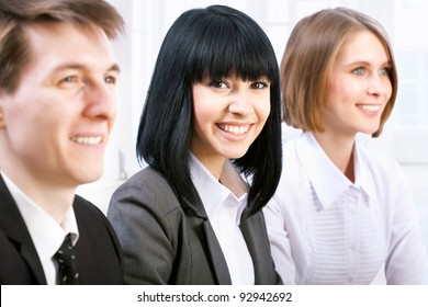 Young Asian businesswoman with colleagues
