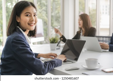 Young asian businesswoman during conference with clients in meeting room.