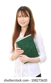 Young asian businesswoman holding a book