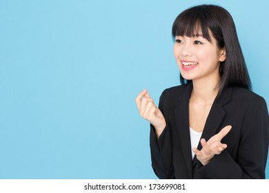 young asian businesswoman interviewing on blue background