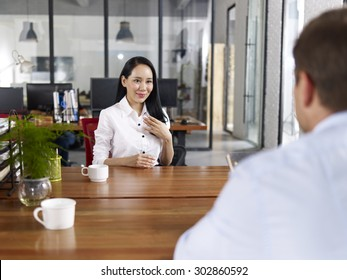 young asian businesswoman looking confident making a self introduction during a job interview.
