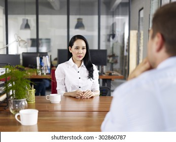 young asian businesswoman looking serious and nervous during a job interview.