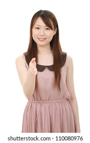 Young asian businesswoman offering handshake over white background