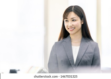 Young asian businesswoman in office.