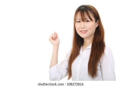 Young asian businesswoman raising her arm in sign of victory