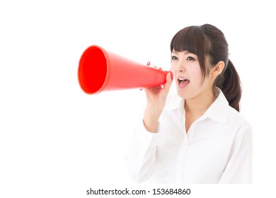 young asian businesswoman with red megaphone on white background