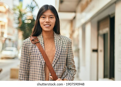 Young asian businesswoman smiling happy standing at the city.