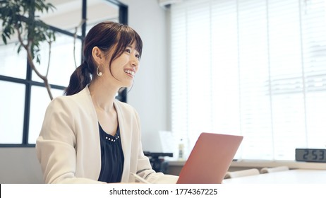 Young asian businesswoman talking in the office. - Shutterstock ID 1774367225