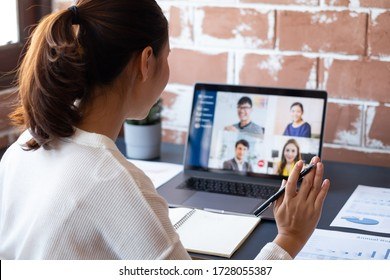 Young Asian businesswoman work at home and virtual video conference meeting with colleagues business people, online working, video call due to social distancing at home office - Shutterstock ID 1728055387