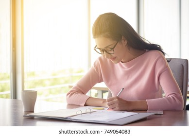 young asian businesswoman working in startup office, happy work concept