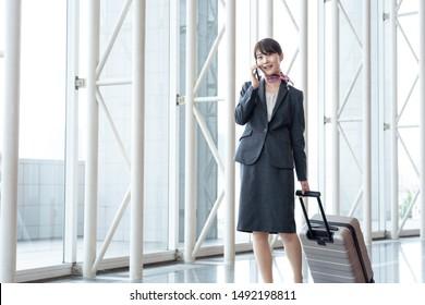 young asian cabin crew walking