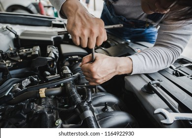 Young Asian car mechanic auto repair service provider.