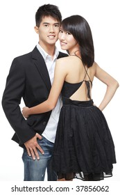Young, asian, chinese couple on a romantic date. Smart casual dress and jacket. Intimate pose.