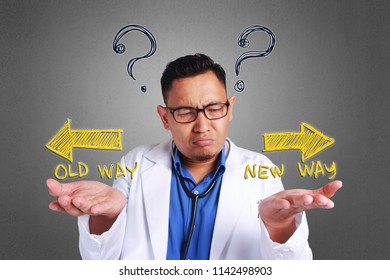 A Young Asian confused doctor trying to decide which side to choose, Old way or new way
