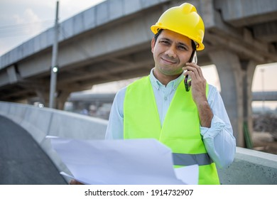 Young asian construction talking on phone at construction site