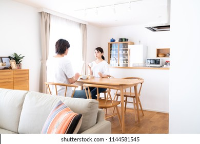 Young asian couple in the dining room.