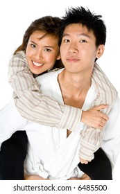 A young Asian couple holding each other on white background