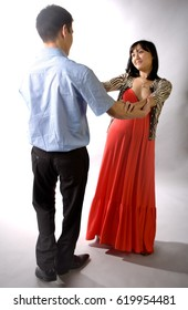 Young Asian couple from Kazakhstan in the studio