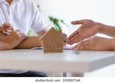 Young Asian couple make contract for new house or apartment with agency or broker prepare for moving in. Business financial and real estate concept.