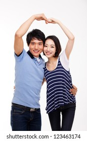 Young Asian couple make heart shape isolated on white background