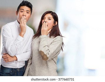 young asian couple surprising