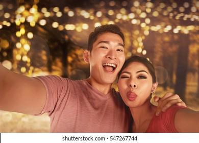Young asian couple taking selfie when dating in outdoor