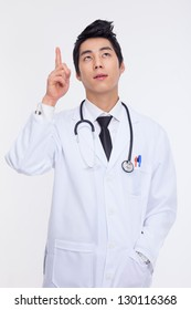 Young Asian doctor indicate upside isolated on white background.