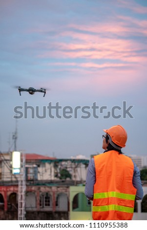 Young Asian Engineer Flying Drone Over Stock Photo (Edit Now