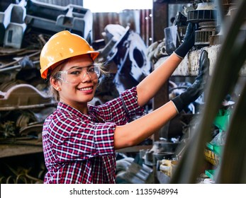 Young Asian Engineer woman  working with machine in factory.