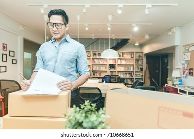 Young asian entrepreneur checking document at home office. Conceptual for startup small businesses starting own company and online marketing.