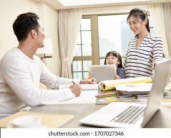 young asian family with one child staying home happy and cheerful