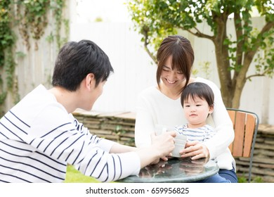 young asian family relaxing in terrace