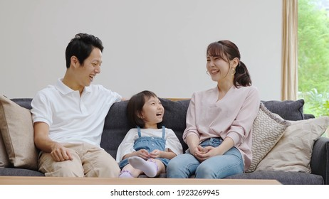 young asian family talking in the living room