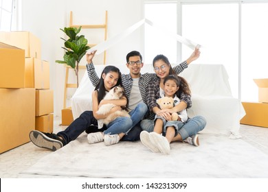 young Asian family team mother, father and children in a new home. concept Starting a family life or housing or rent. Happy Asian Parents Sitting On Floor At new room Playing With children and cat