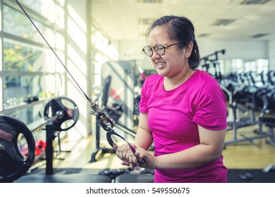 young asian fat woman be tired exercise in gym