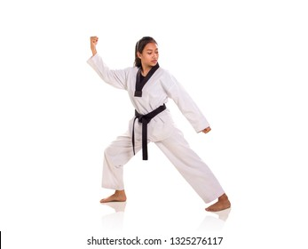 Young Asian female dressed in kimono striking a martial arts pose, full length portrait, isolated over white background