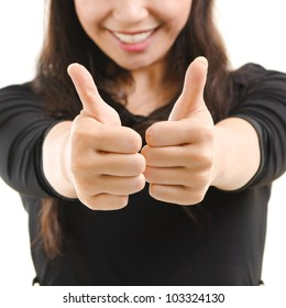 Young Asian female giving thumbs up sign isolated on white background