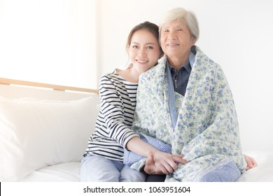 young Asian female hug old female, mother's day , family time
