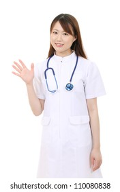 Young asian female nurse waving hand