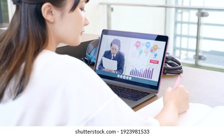 Young asian female student taking online lessons.
