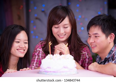 young asian friends at birthday party