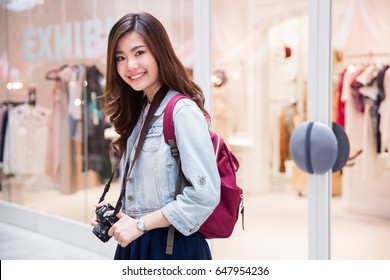 Young Asian girl backpacking