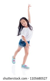 Young asian girl dancing and smiles over white background