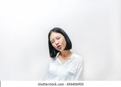 Young asian girl doing emotion. Dressed in a white shirt and blue jean in hipster style.  White background.