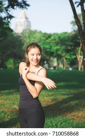 Young Asian Girl doing exercise in park