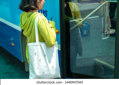 Young Asian girl getting on the bus