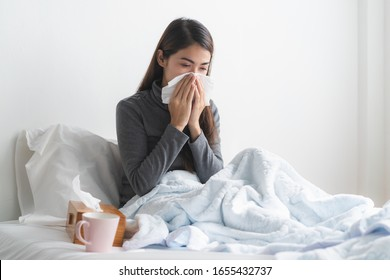 Young asian girl have running nose and sick in the bedroom.